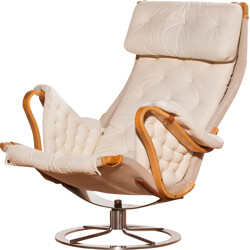 Mid-century lounge chair in leather and chromed metal - 1960s