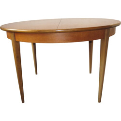 Round extendible dining table in massive wood - 1960s
