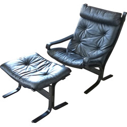 Scandinavian armchair in black leather and ottoman Ingmar Relling - 1970s