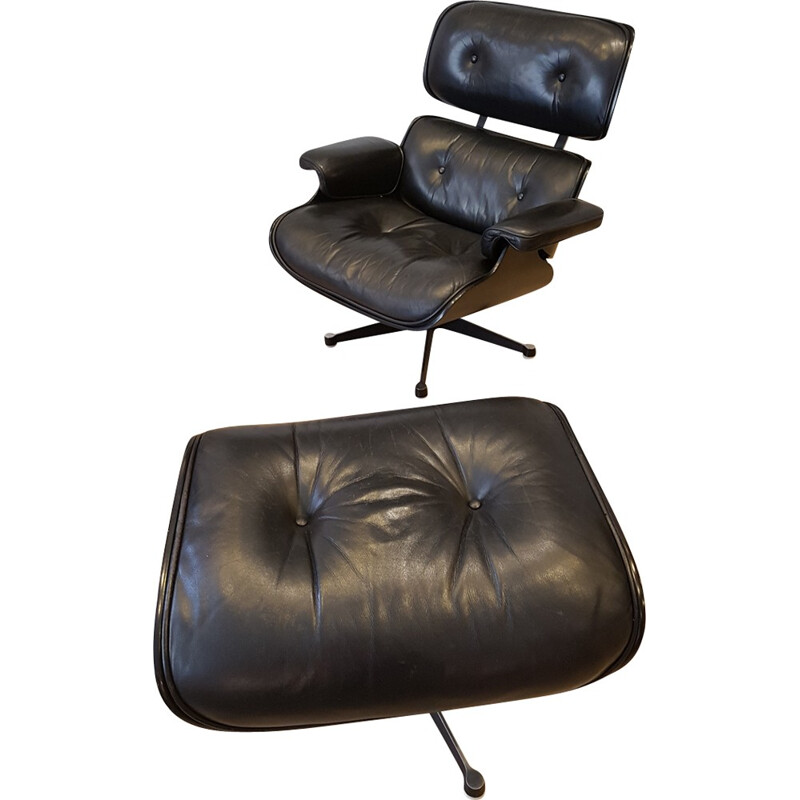 Set of an armchair and ottoman by Charles and Ray Eames produced by Mobilier International - 1980s