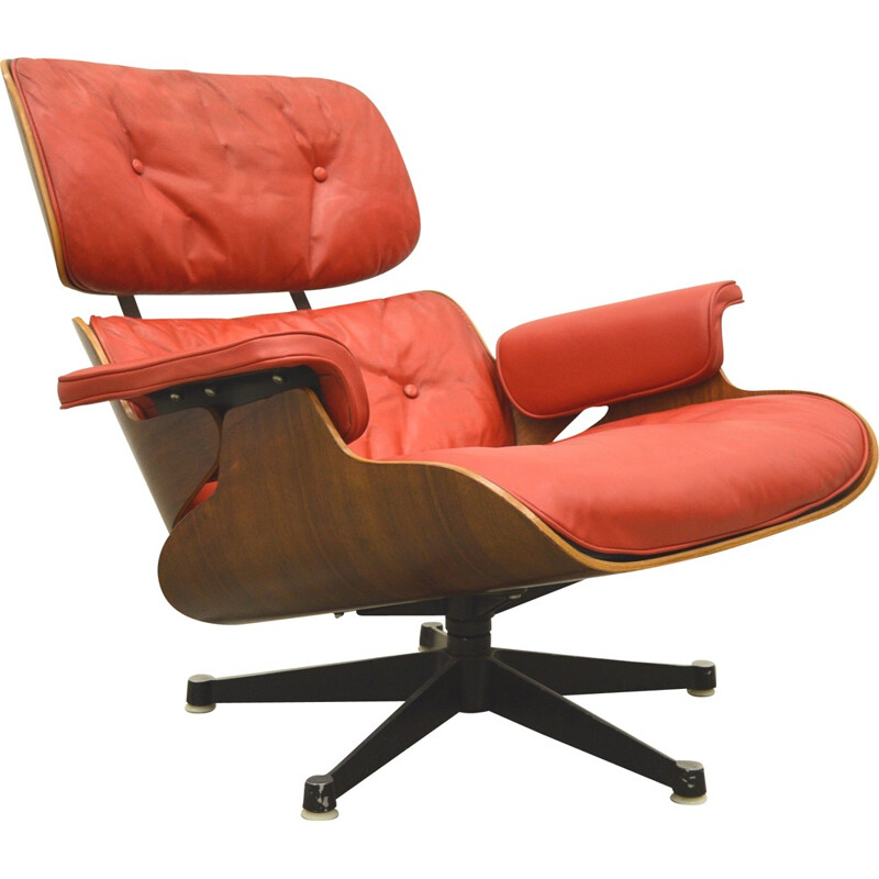 Vintage lounge chair and ottoman in read leather by Herman Miller for Charles & Ray Eames - 1950s