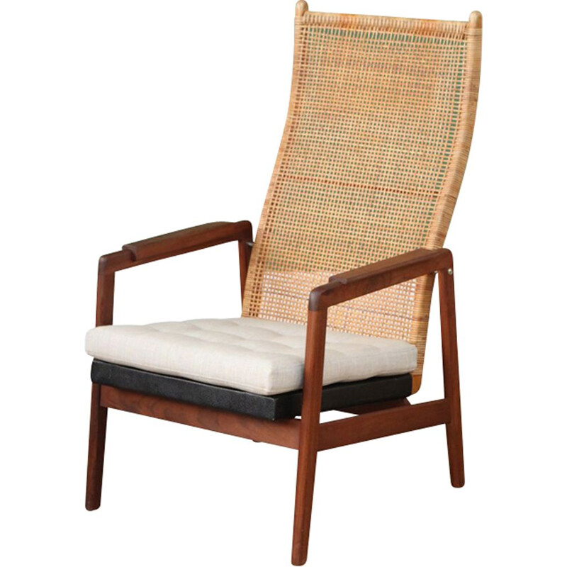 Vintage armchair with high back in rattan by P.J. Muntendam