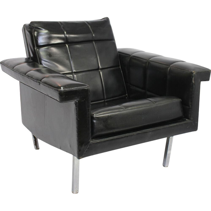 Vintage easy chair in leather and chromed metal