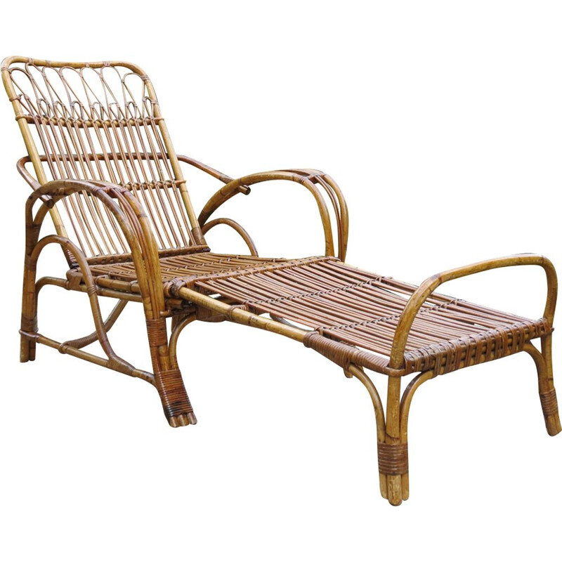 Vintage chaise lounge with footstool in cane and rattan
