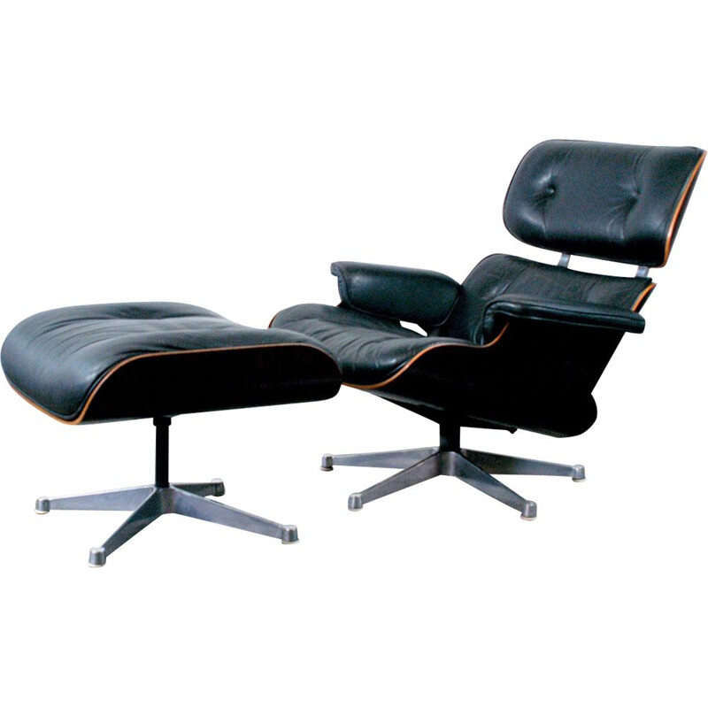 Vintage lounge chair and ottoman in rosewood by Eames for Herman Miller