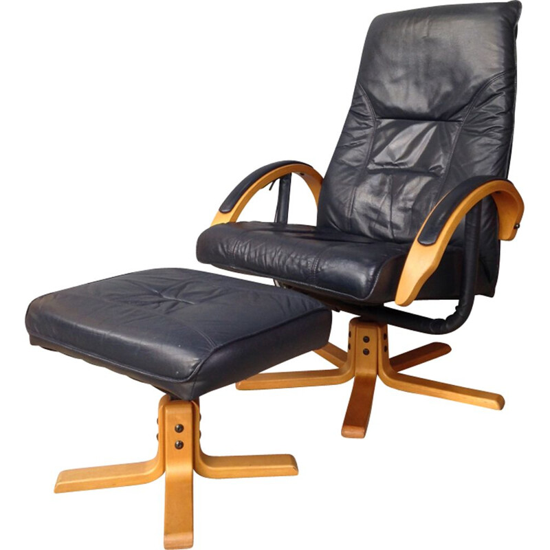 Vintage armchair in leather and wood with ottoman by Unico Denmark