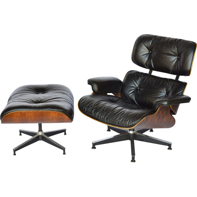 Lounge chair and footstool in rosewood by Eames for Herman Miller 1979
