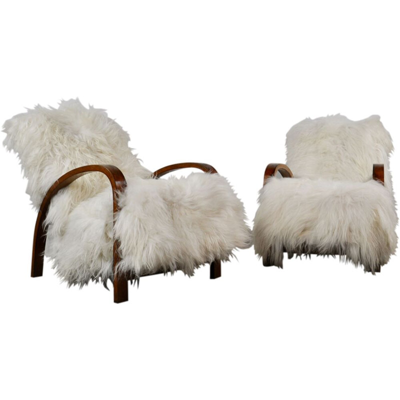 Set of 2 vintage French armchairs in sheepskin