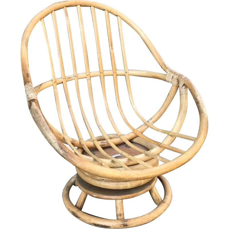 Vintage swivel chair in rattan