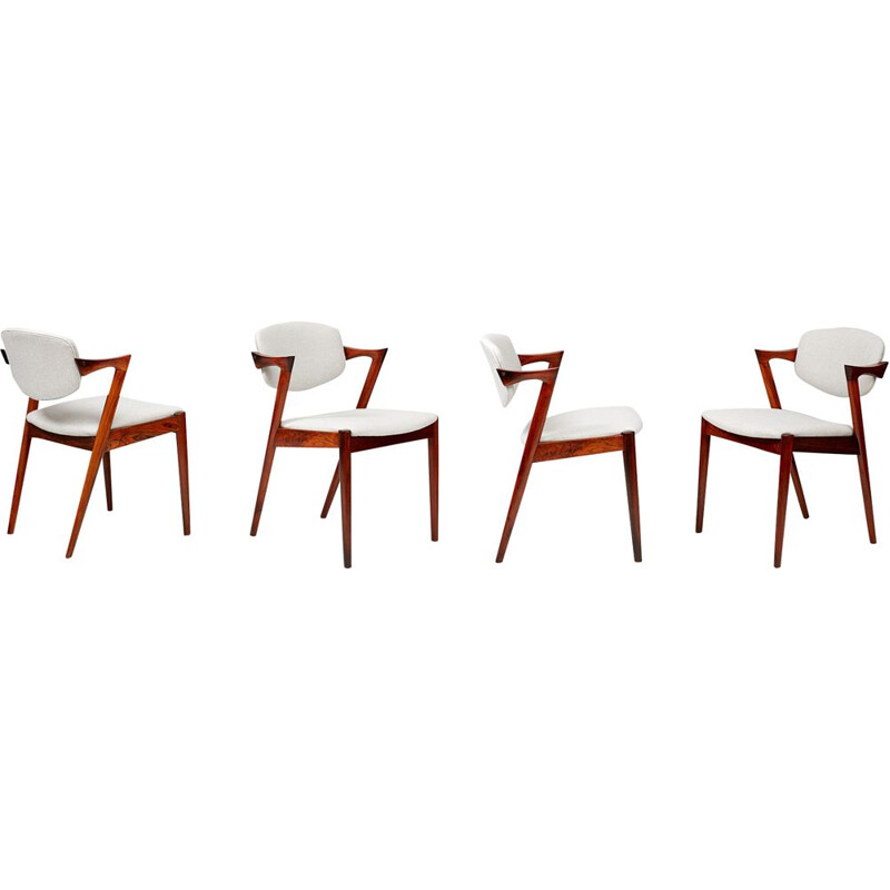 Set of 8 vintage dining chairs model 42 by Kai Kristiansen