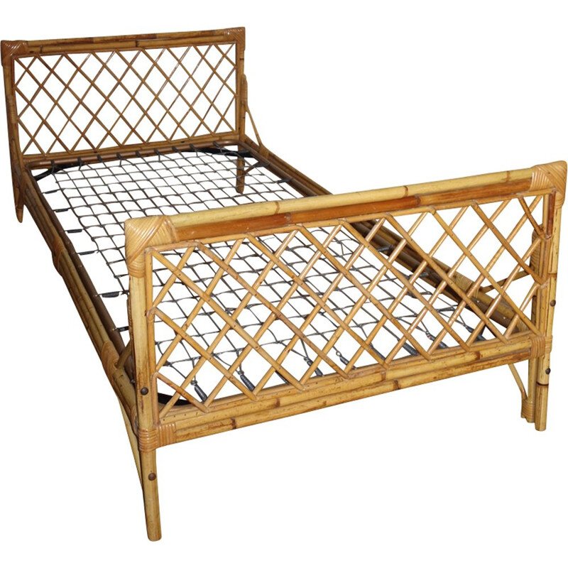 Vintage French bed in rattan