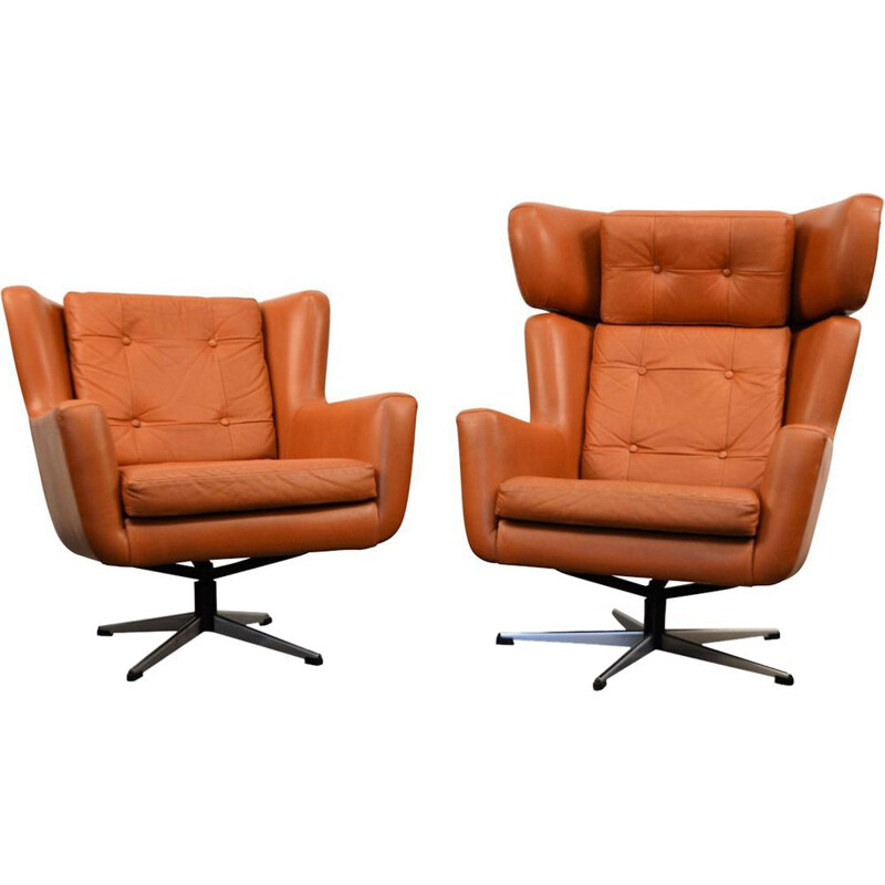 Set of 2 swiveling leather amrchairs by Skjold Sorensen