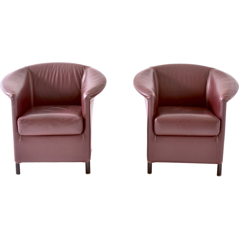 Pair of burgundy armchairs by Paolo Piva