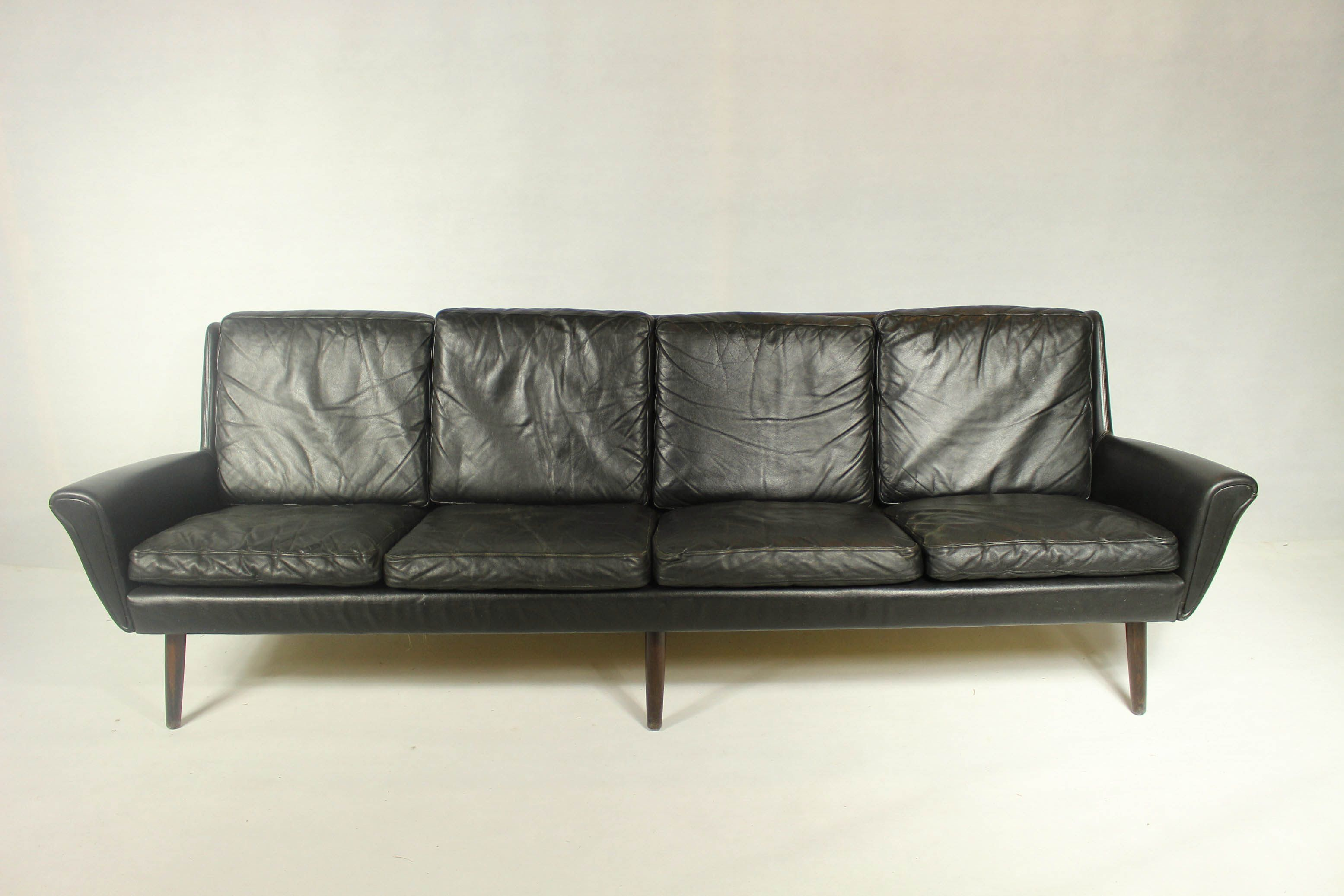 Vintage 4 Seater Sofa In Black Leather Previous Next