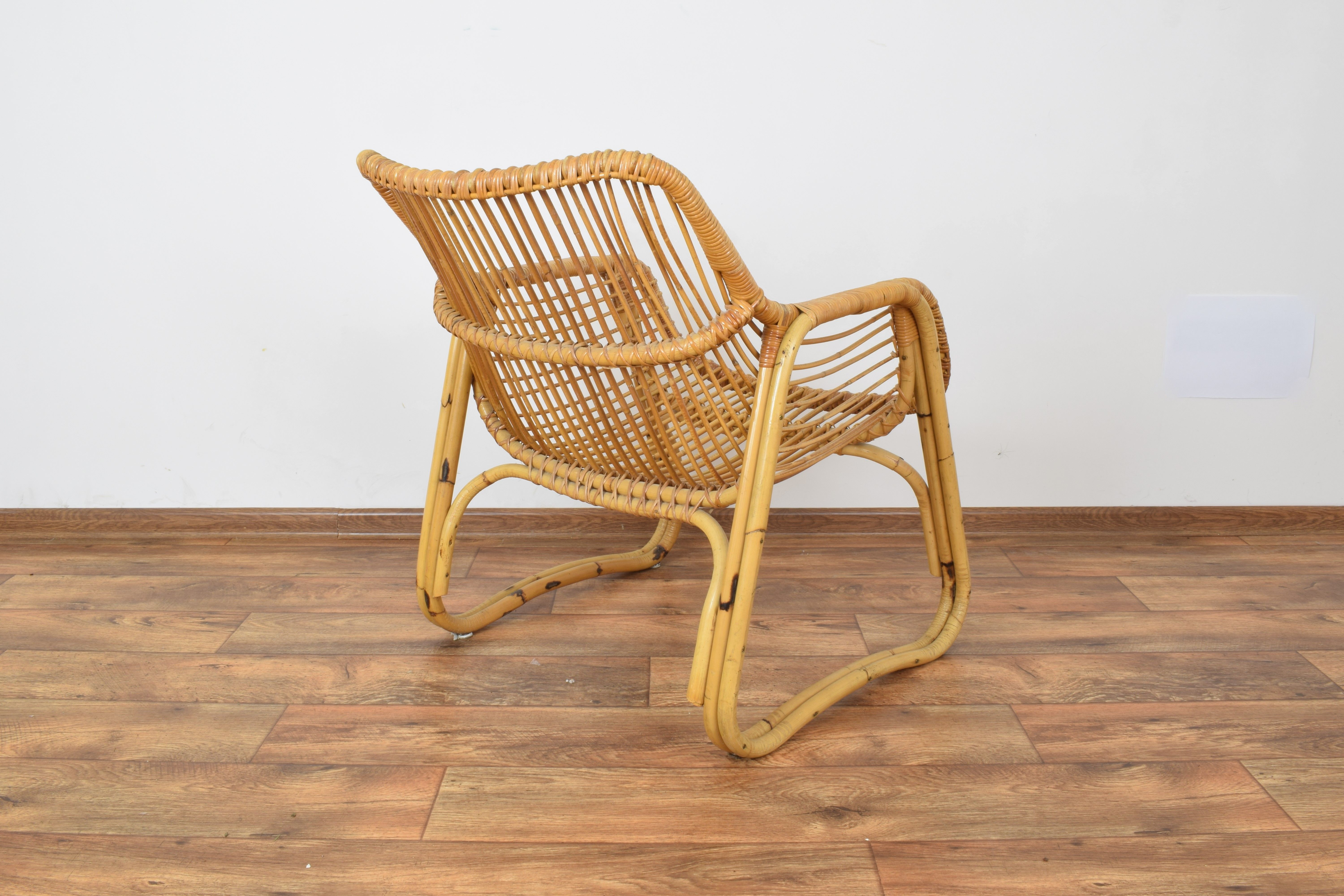 Vintage German armchair in rattan - Design Market