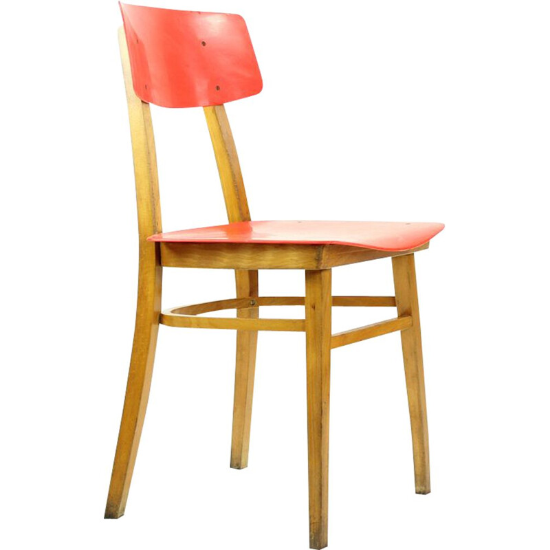 Vintage red chair in plastic and beechwood