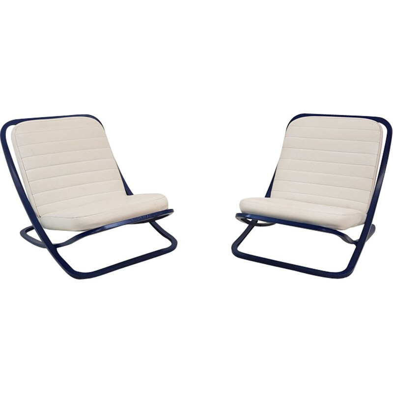 Pair of white lounge chairs in leatherette