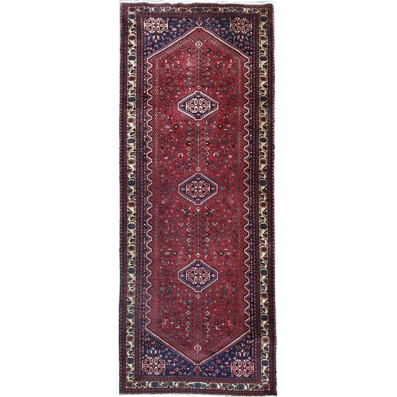 Red Persian carpet in wool