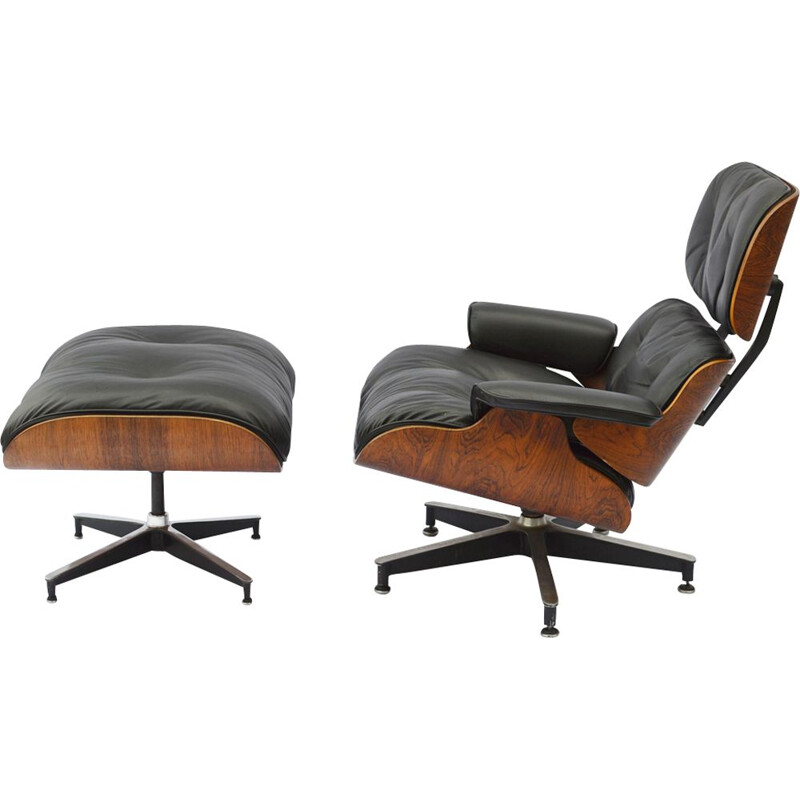 Vintage lounge chair & ottoman in rosewood by Eames for Herman Miller