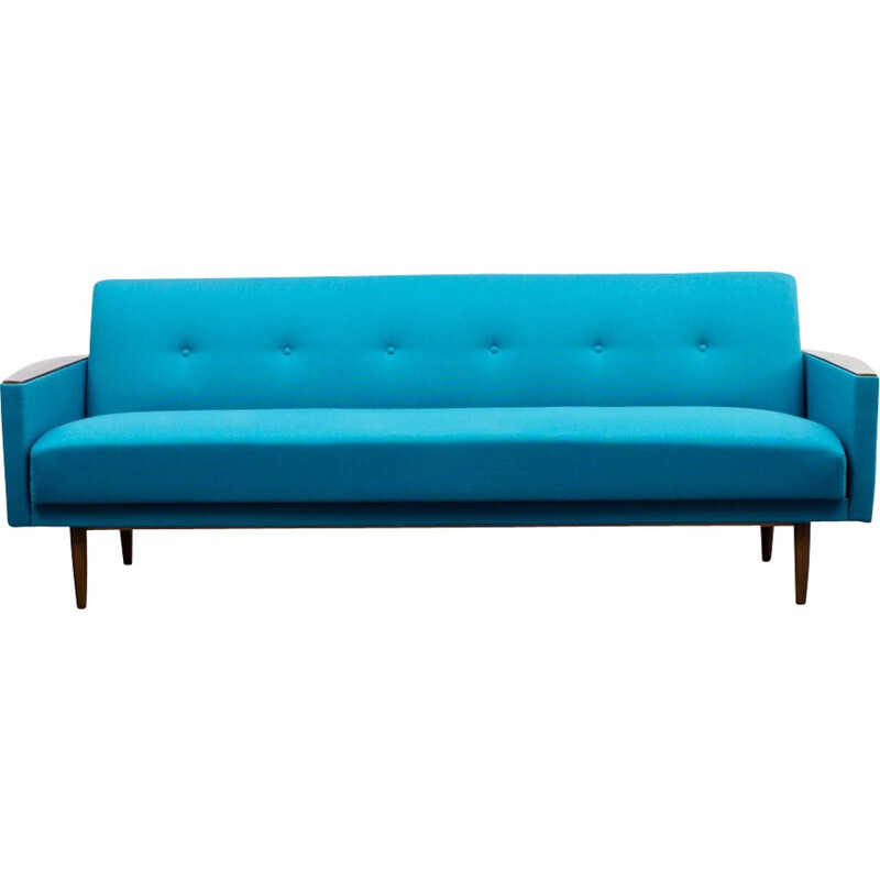 Vintage sofa with fold out bed in petrol blue