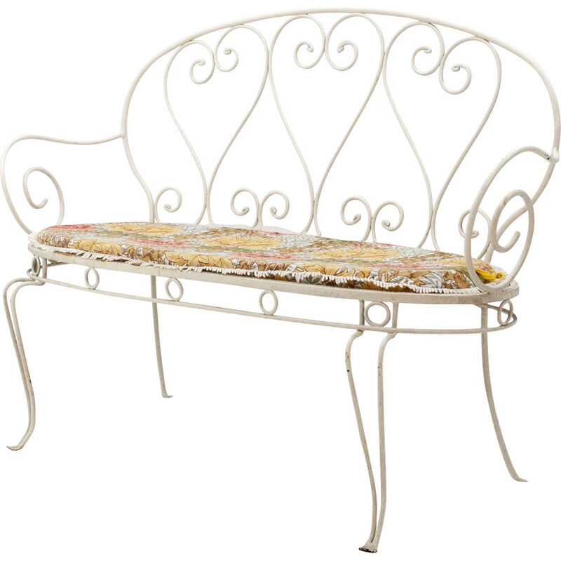 Vintage white garden bench in metal