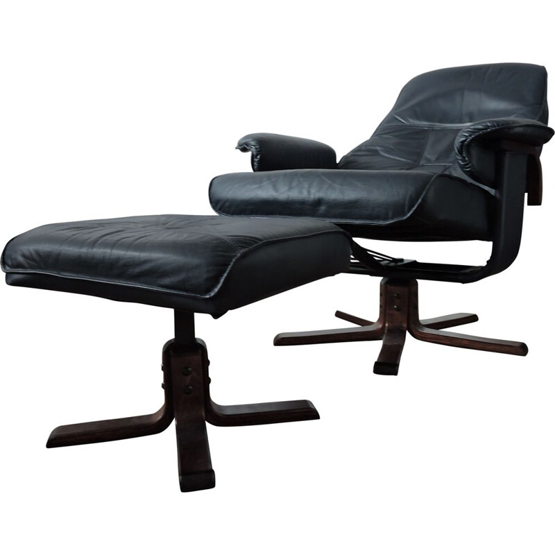 Black leather armchair and ottoman from Unico