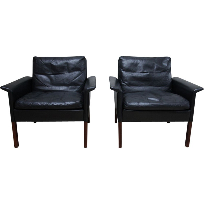 Pair of black leather Club armchairs by Hans Olsen