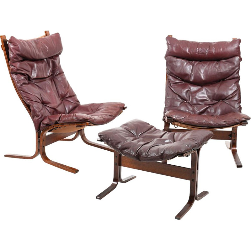 Pair of burgundy lounge chairs by Ingmar Relling