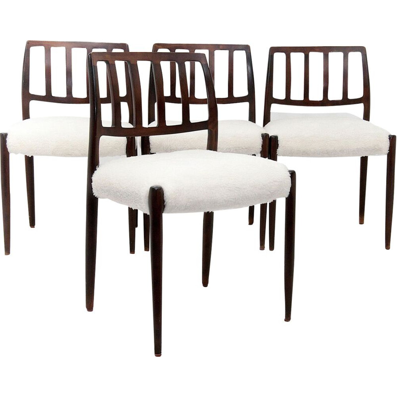 Set of 4 white chairs in teak by Niels O. Moller
