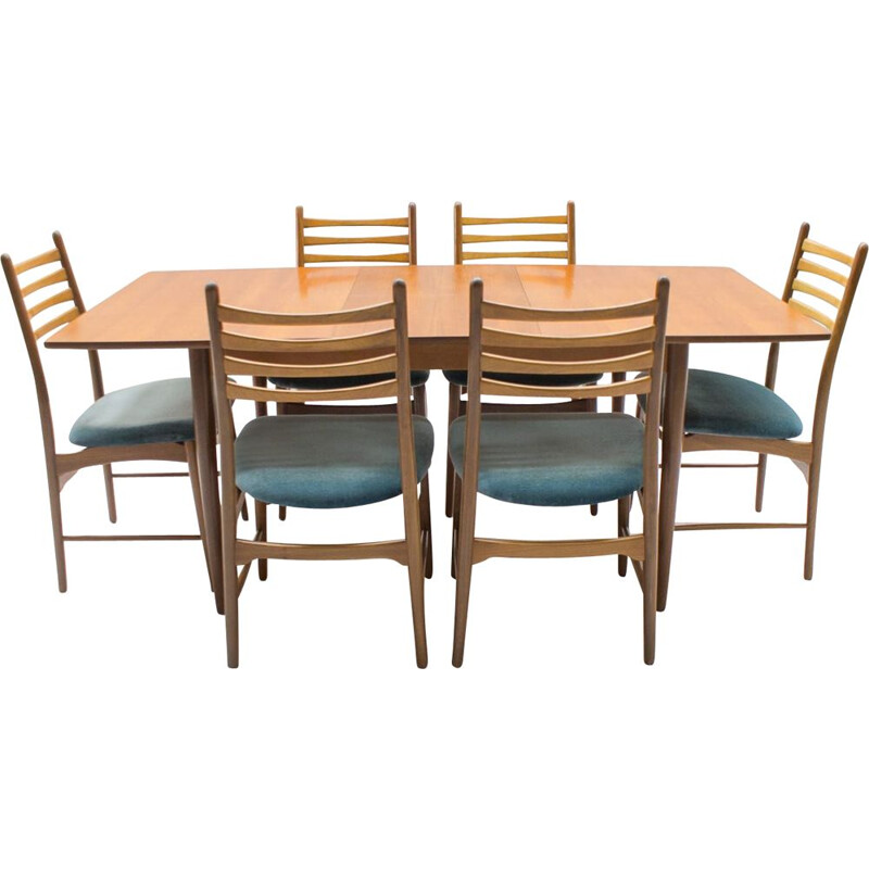 Set of vintage extendable teak table and 7 chairs 1960s