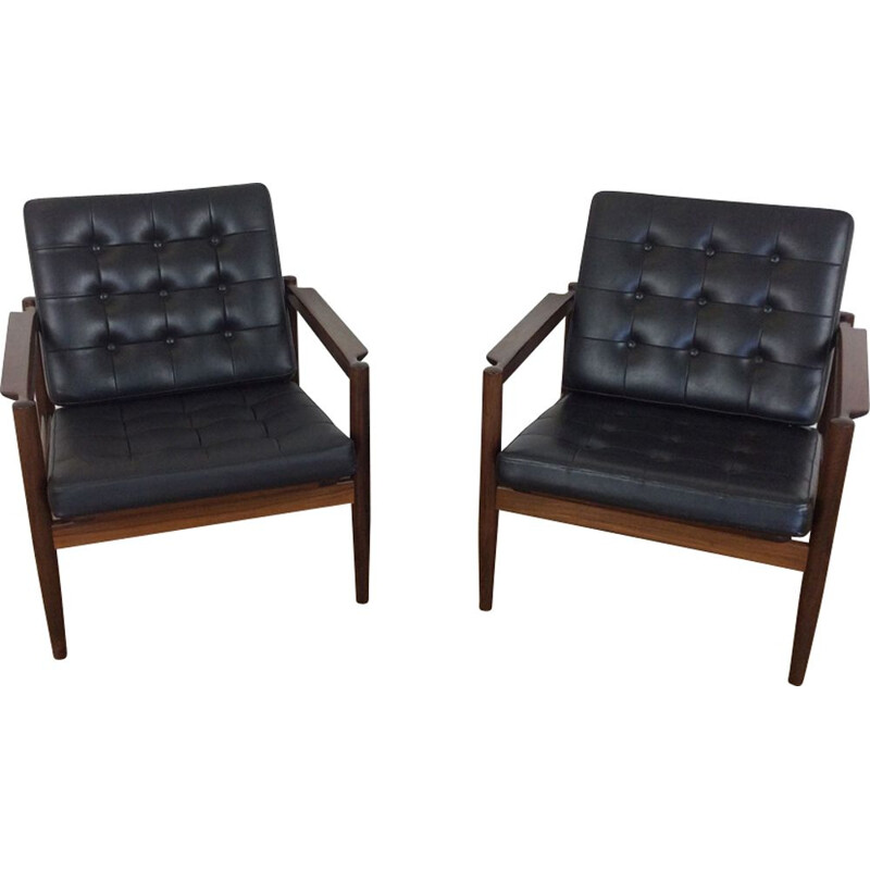 Pair of black rosewood armchairs by Borge Jensen