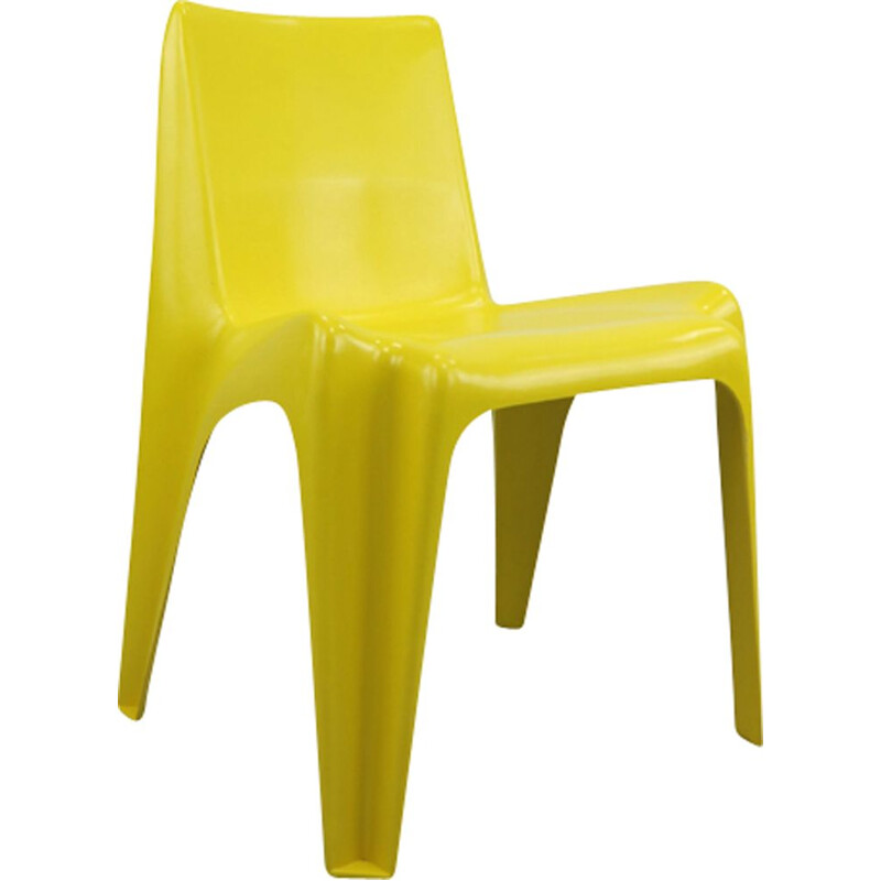 Yellow chair in fiberglass by Helmut Bätzner