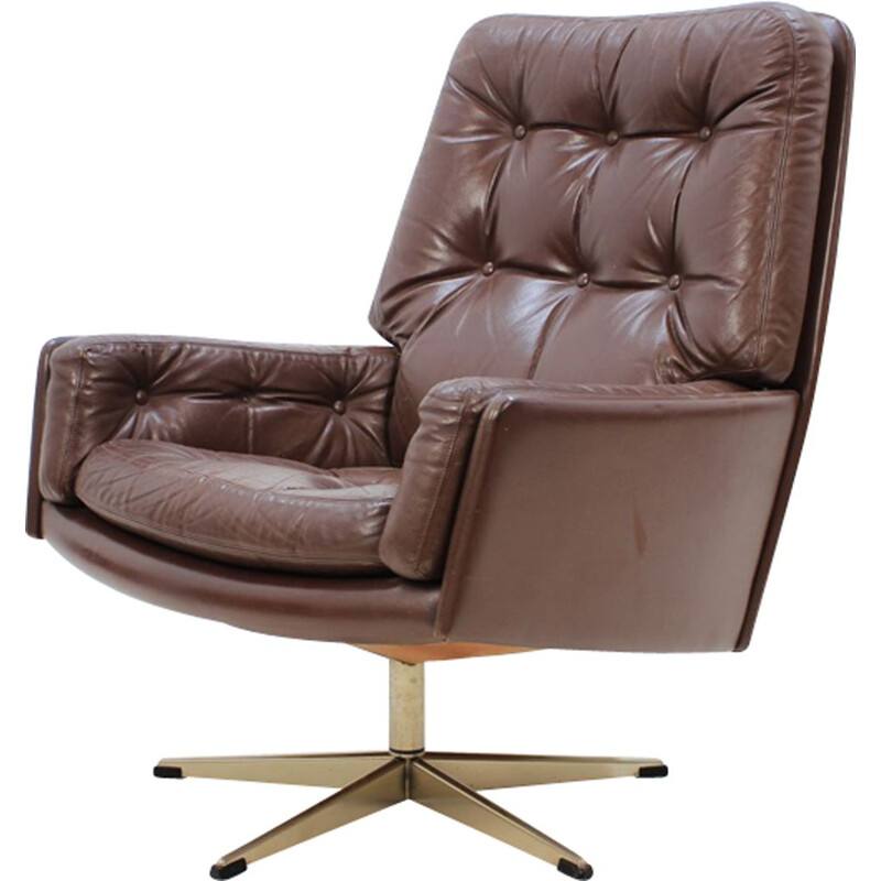 Danish swiveling armchair in brown leather