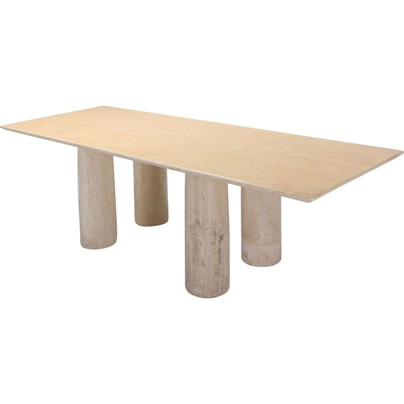 Dining table in travertine by Mario Bellini