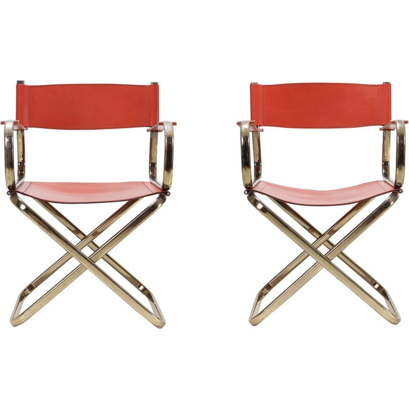 Pair of brass and red leather chairs