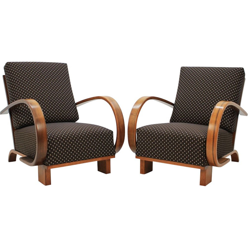 Pair of walnut armchairs by Jindrich Halabala