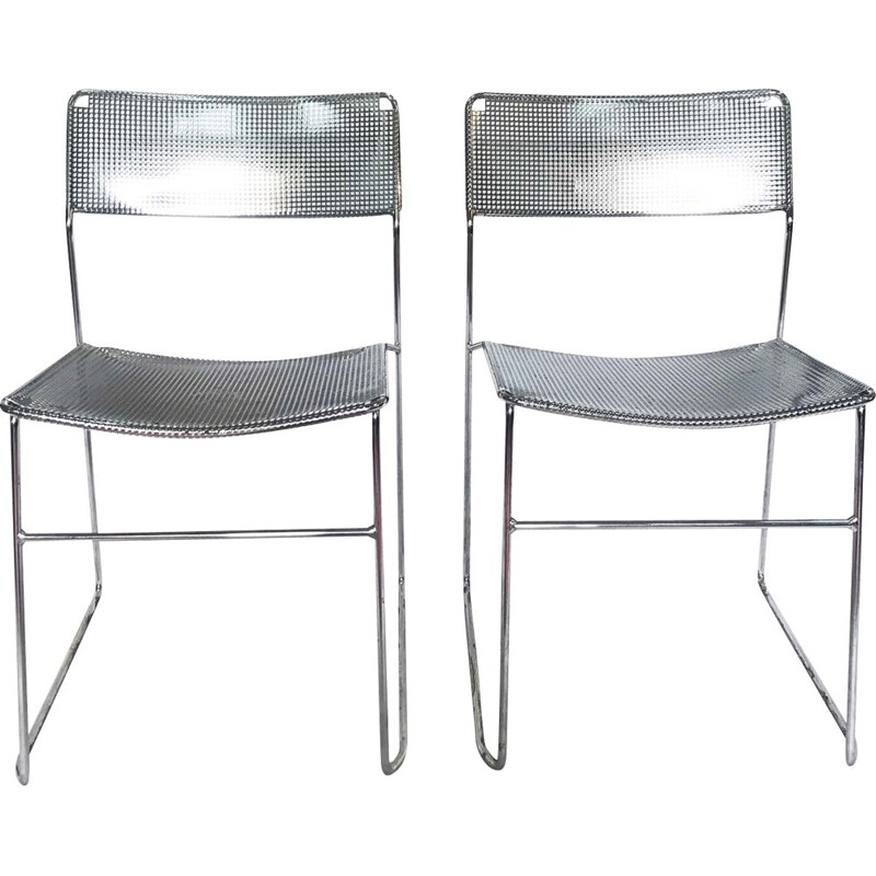 Set of 2 perforated chromed steel chairs by Niels Jorgen Haugesen for Magis