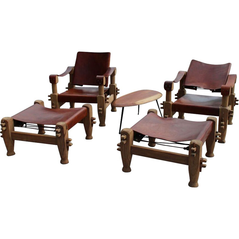 Pair of armchairs and ottomans in tawny leather laced 1960 s