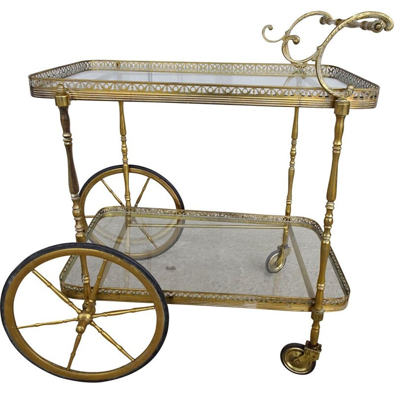 Vintage serving trolley in golden metal