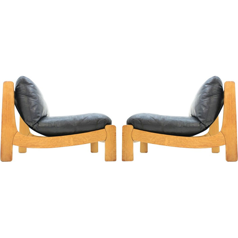 Pair of vintage scandinavian armchairs in black leather and wood 1970