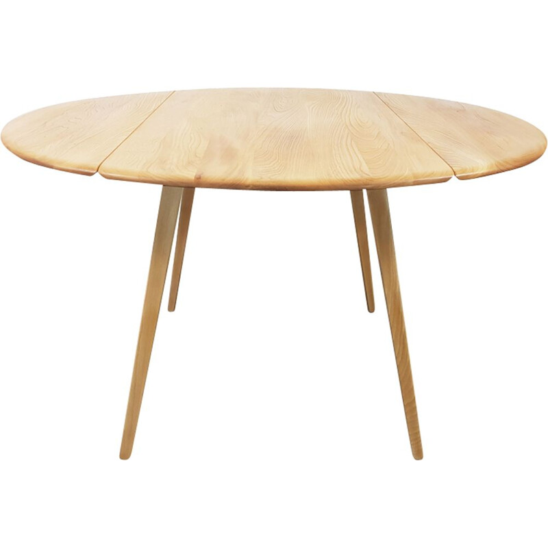 Vintage dining table in elm, Drop Leaf, Round by Lucian Ercolani for Ercol, 1960s.