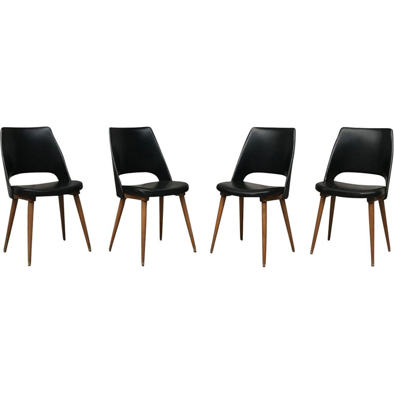 Set of 4 black Barrel chairs by Baumann