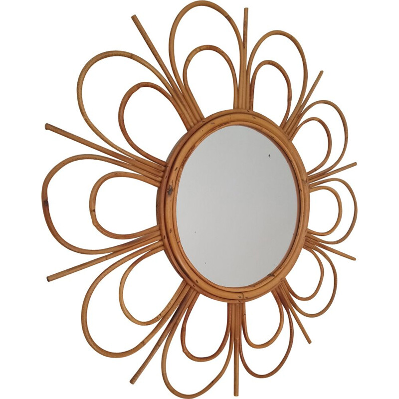 Vintage flower-shaped mirror in rattan