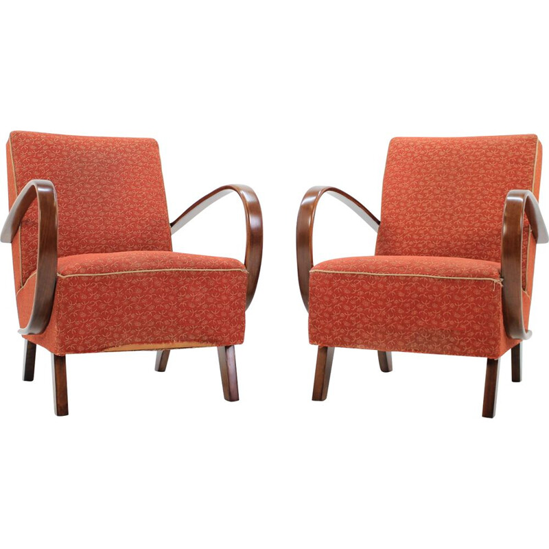 Pair of red armchairs by Jindřich Halabala