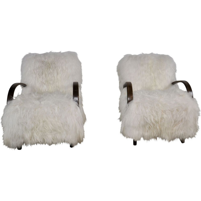 Pair of sheepskin armchairs by Jindrich Halabala