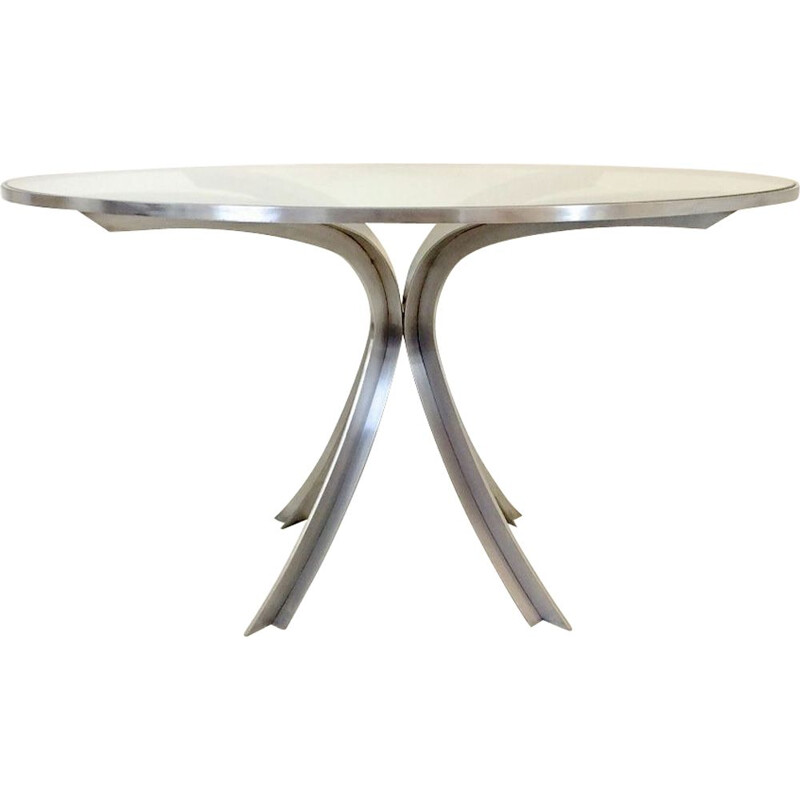Round table in brushed steel by Xavier Féal