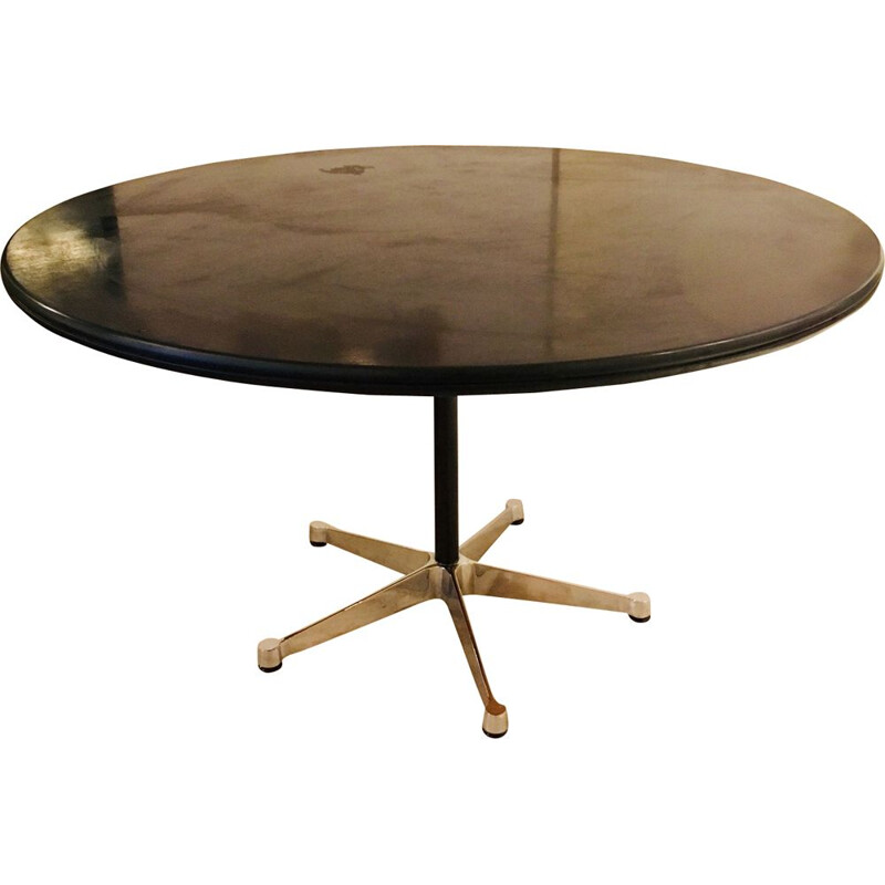 Circular table in birchwood by Eames for Vitra