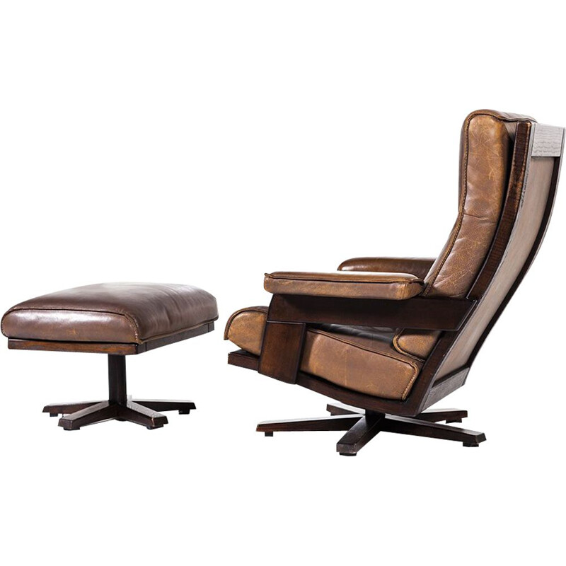 Vintage lounge swivel chair and ottoman by Harry de Groot for Leolux