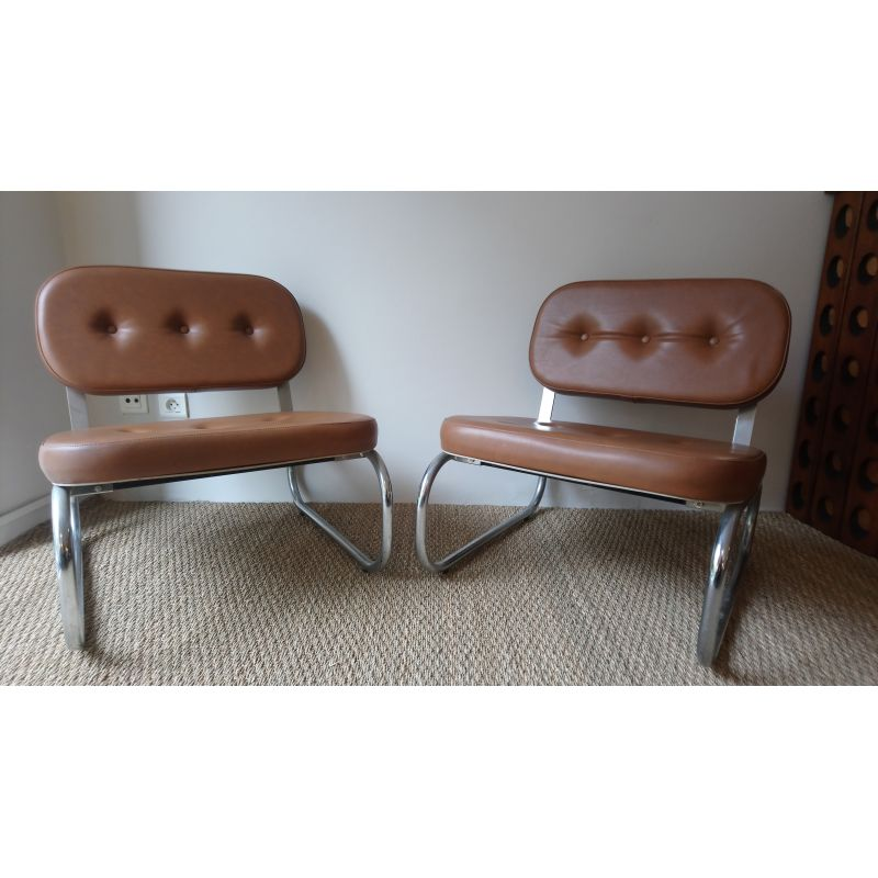 30430082a Pair of vintage tubular armchairs in chrome and brown leatherette. Vintage Designer  Furniture