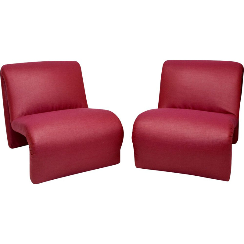 Pair of red low chairs by Etienne Fermigier